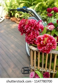 The bike has a flower pot in front (Basket)
