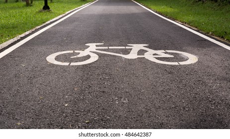 Bike lane, Bicycle sign or icon and movement of cyclist in the park