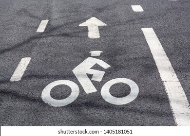 Bike lane road markings on a road pavement