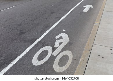 Bike lane road markings on a road pavement in Boston, Massachusetts, USA.