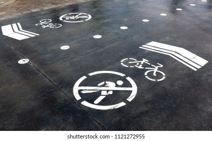 Bike lane with road symbols painting on asphalt