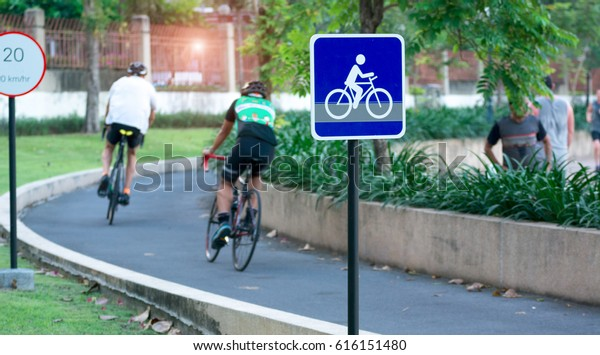 Bike lane and bike sign in middle of park in Bangkok. Cyclists always spend their time on bicycles. They ride it for exercise and relaxiation.