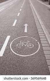 Bike Lane Symbol, Bonn, Germany in Black and White Sepia Tone