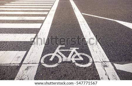 Bike Lane Symbol Crosswalk On Asphalt Stock Photo Edit Now