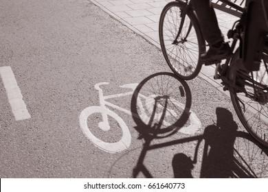Bike Lane Symbol; Stockholm; Sweden in Black and White Sepia Tone