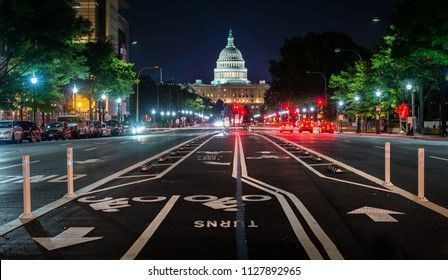Bike lanes on Pennsylvania Avenue and the United States Capitol at night, in Washington, DC.