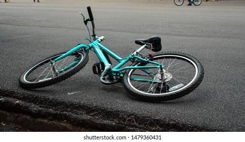 bike laying on the street
