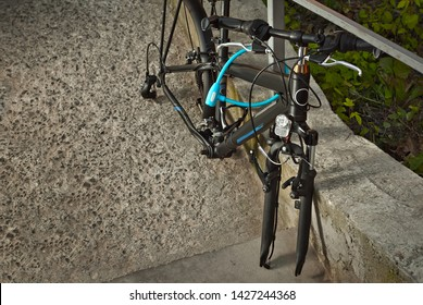 The bike is locked to the metal handrails. Theft of bicycles. Stolen wheels
