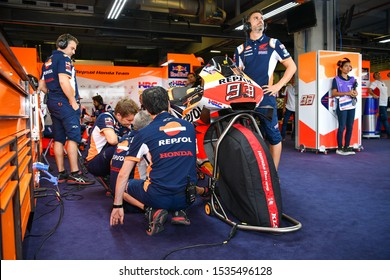 The Bike Marc Marquez with mechanics Repsol Honda Team in pit during of The PTT Thailand Grand Prix-Free-Practice 2 at Chang International Circuit on October 04,2019, in Burirum Thailand