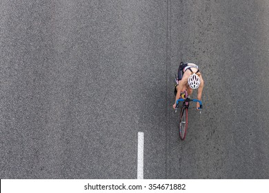 Bike on the asphalt road, top view