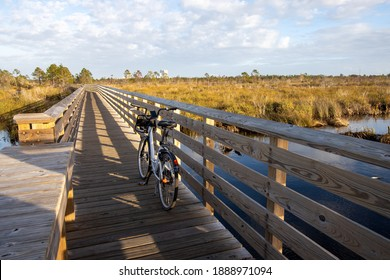 Bike on boardwalk at outlook for Shelby Lakes at Gulf State Park