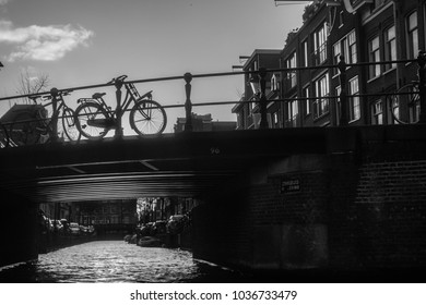 Bike on the bridge on the background of the setting sun