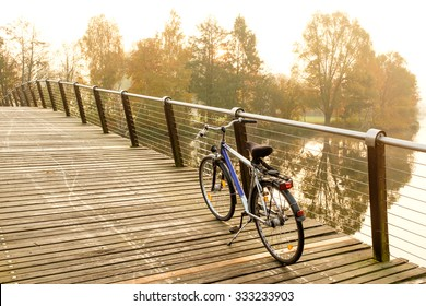 Bike on bridge over the river in Potsdam countryside during a break in morning fitness ride
