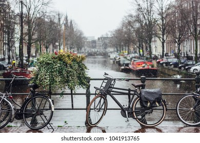 Bike on day light during the rain. Amsterdam