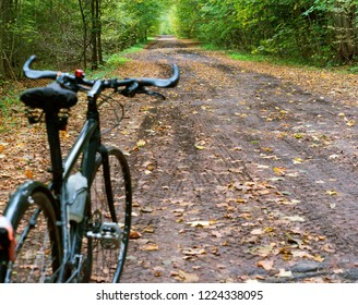 bike on forest trail, black bike in forest in autumn