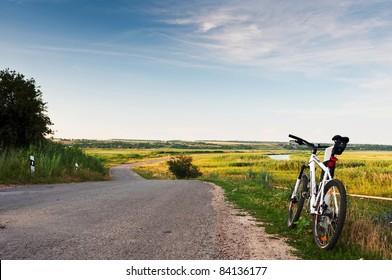Bike on the road. Beautiful non-urban landscape.
