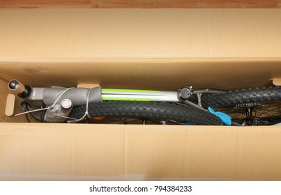 Bike in paper box, photo from unboxing bike. Saddle, front wheel  and handlebars are removable.