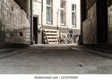 Bike parked beside tall building. Photo taken in Berlin, Germany.