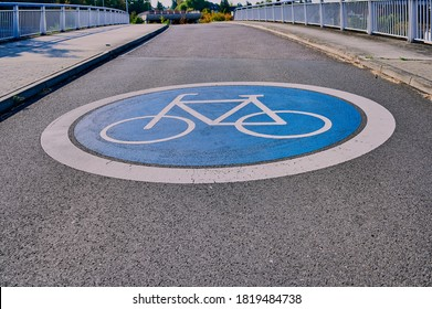 bike path with blue icon on a road in Germany