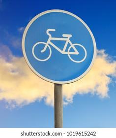 bike path sign close-up on sky background