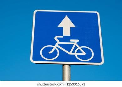Bike path sign on a blue sky background