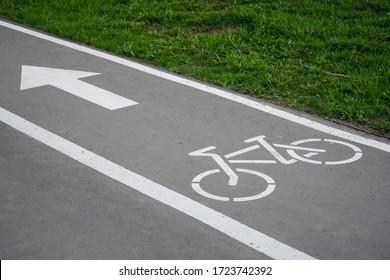 Bike path, a symbol of a Bicycle path on asphalt in a Park. Bike lane
