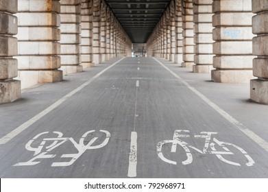 Bike path under Bercy bridge in Paris, France
