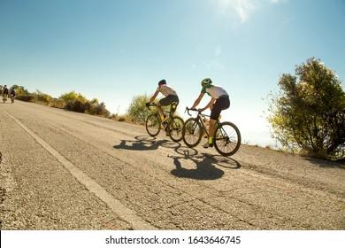 bike race in the morning on  uphill road  in ioannina city greece