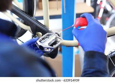 Bike, repair and maintenance.Man tightens and lubricates the pedals in the bike