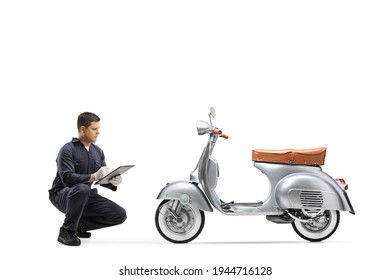 Bike repair mechanic kneeling in front of a vintage scooter isolated on white background