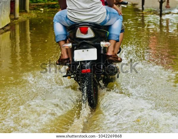 Bike rider biking a motorbike in the water