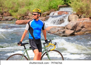 Bike rider by the river