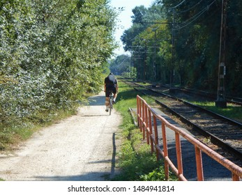 Bike rider in the nature on the edge of the city Budapest along the tram rail