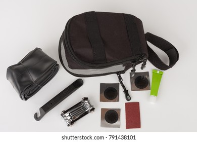 Bike saddle bag and set of tools  for repairing  punctured tube, isolated on white background, studio photo.