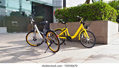 Bike sharing bicycles parked in front of corporate building