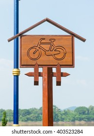 Bike Sign indicating bike route wooden. Wooden bicycle lane sign against a blue sky.