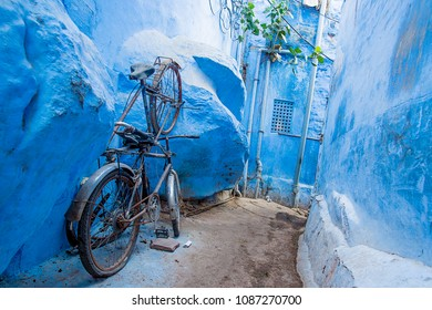 A bike in a small alleyway in the blue city of Jodhpur, Rajasthan, India.