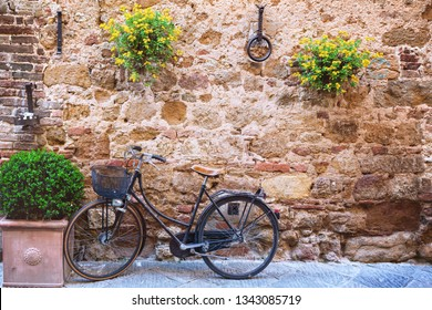 bike standing at the empty street of old italian town. Pienza, Tuscany, Italy