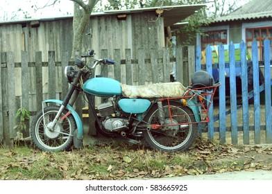 Bike standing near the fence