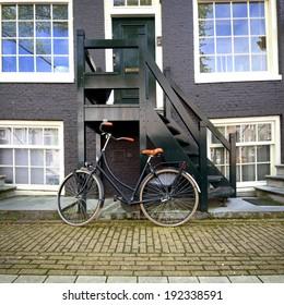 Bike standing on the street in Amsterdam