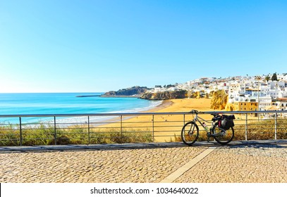 Bike tourism in Albufeira beach, Algarve, south of Portugal.