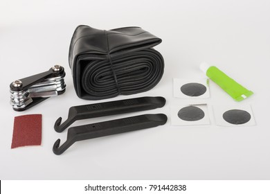 Bike tyre tube puncture repair tool kit, set of tools  for repairing  punctured tube, isolated on white background, studio photo.