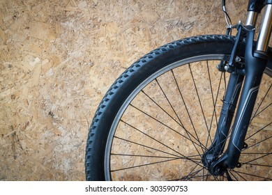 Bike wheel on wooden background