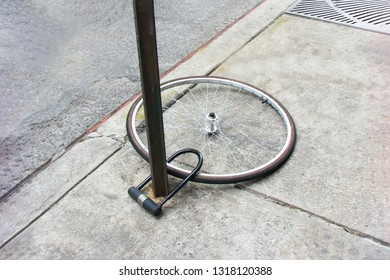 Bike wheel with padlock. Theft of a bicycle. Bicycle stolen and left only wheel