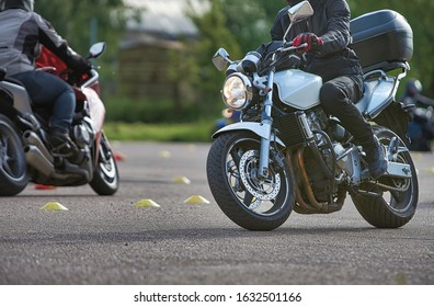 The biker in action or movement, riding around a curve road. - Shutterstock ID 1632501166