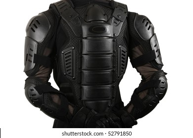 Biker back close up in protective suit of armor with hands crossed at the back