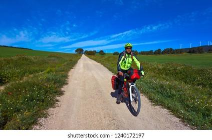 Biker by Camino de Santiago in bicycle at Saint James Way of Levante of Spain