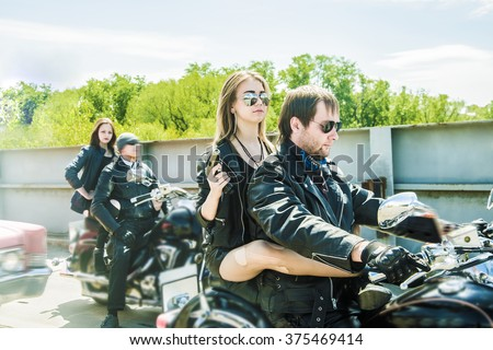 1bf61706eb Biker Couple with motorcycle Chopper style Man and woman ride with high  speed Cute girl wear