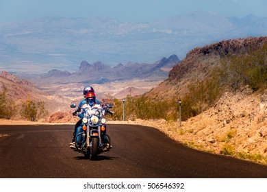 Biker driving on the highway on legendary Route 66 to Oatman, Arizona, USA