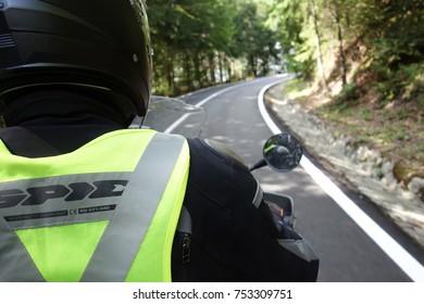 Biker driving a red BMW GS R 1200 Adventure on the Transfagarasan road in Fagaras Mountain, Romania 22 August 2017